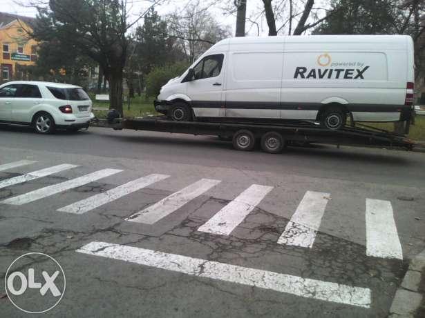 18546087_2_644x461_tractari-microbuze-international-fotografii_rev008
